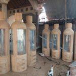 Lemari Pajangan Minimalis Jati Botol Unik
